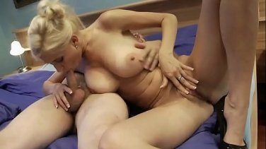 Blond beauty gets sex without undressing